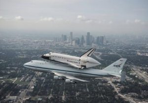 "Reuters Photo and Article: ""The space shuttle Endeavour, atop NASA's Shuttle Carrier Aircraft, flies over Houston, Texas in this September 19, 2012 NASA handout photo. REUTERS/Sheir Locke/NASA/Handout"""