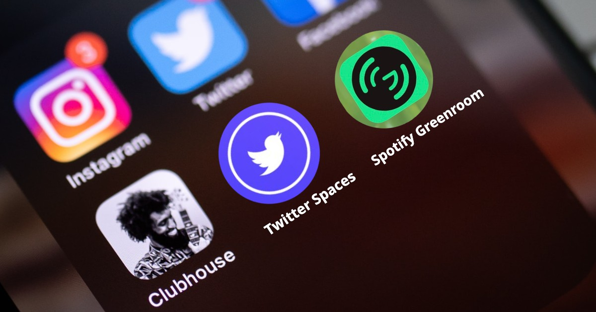 Image of a cell phone zoomed onto social audio apps Clubhouse, Twitter Spaces, and Spotify's Greenroom