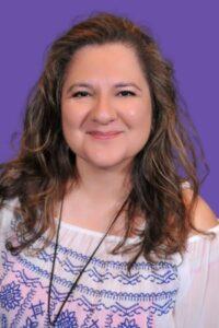 Jennifer Navarrete in front of a purple background